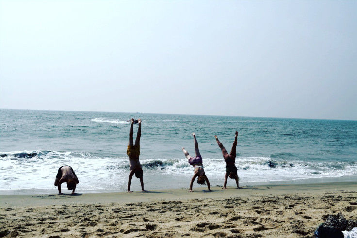 Headstand at Kochi Beach